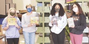Book sorting pic #1: (left to right) Madalyn VanLandeghem (Rotary Interact President), Marty Barta, Arissa Presley and Lauren Brokaw. Photo provided